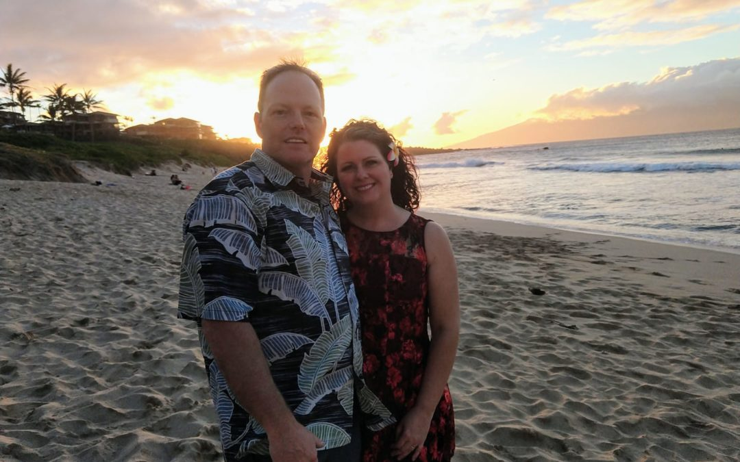 The owners of New Creations USA, Dave and Kelly Stone, standing together in the sunset.